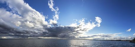 Large panorama of the coastal line with storm clouds. stock images