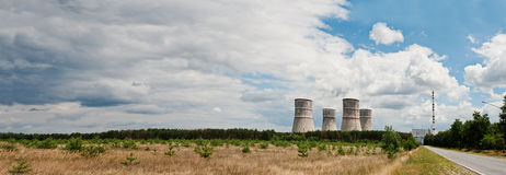 Large panorama of nuclear power station. Tops of cooling towers Stock Photo