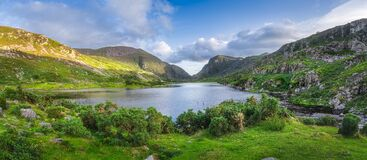 Free Large Panorama With Black Lake Valley And Mountains At Sunset In Gap Of Dunloe, Black Valley Royalty Free Stock Photos - 217647358
