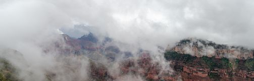 Large panoramic view on Grand Canyon under heavy fog. USA stock photos
