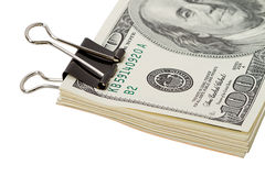 Large paper clip and dollars Stock Images