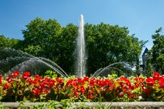 A large park fountain in the center of Poznan. Surrounded by flower beds.  stock photo