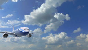 Large passenger aircraft flying very close to the camera against the blue cloudy sky stock video