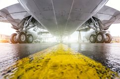 Large passenger aircraft parked at the airport, bottom view wing and landing gear. stock photography
