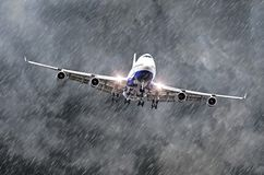 Large passenger airplane approaches the landing at the airport of rain, bad weather. stock photo