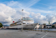 A large passenger liner at the pier in Bergen Stock Images