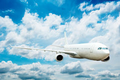 Large passenger plane. Flying in the blue sky royalty free illustration