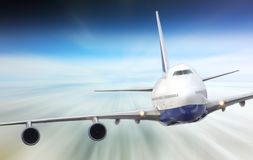 Large passenger plane  in  blue sky Royalty Free Stock Photography