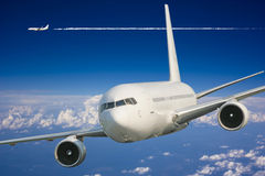 Large passenger plane  in  blue sky Stock Image