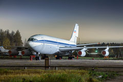 Large passenger plane on a concrete strip at night. Aircraft parking Stock Images