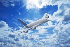 Large passenger plane. Flying in the blue sky Stock Image