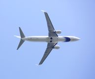 Large passenger plane flying high in the sky Stock Photo