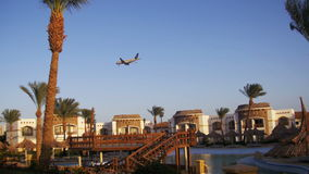 Large Passenger Plane Flying in the Sky over Hotels in Egypt stock footage