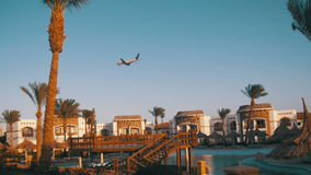 Large Passenger Plane Flying in the Sky over Hotels in Egypt stock video footage