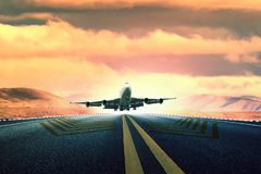 Large passenger plane take off from airport runway stock photos
