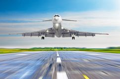 Large passenger plane take off from the runway before the light from the sunshine. royalty free stock photos