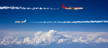 Large passenger planes  in  blue sky. Large passenger planes flying in the blue sky Royalty Free Stock Photos