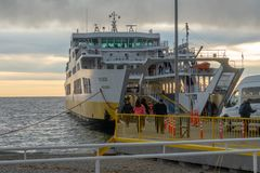 Large Passenger Ship. People board a large passenger boat in Punta Arenas, Chile, car, outdoors, south, america, tierra, del, fuego, vacation, arrival, blue stock photography