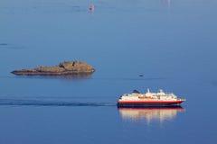 Cruising ship by rock island Royalty Free Stock Photo