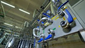 A large pasteurization workshop and its control board. A large pasteurization facility with a control board in close view stock footage
