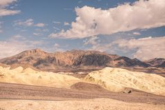 A large patch of clouds hang over the desert of Death Valley. Arizona stock photo
