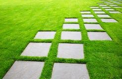 Large Pavers on Diagonal. Diagonal Rows of Large Stone Pavers green grass lawn royalty free stock image