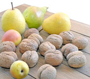 Large pears and walnuts on the table Royalty Free Stock Photos
