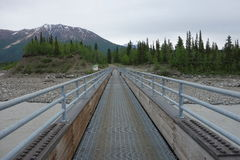 A large pedestrian bridge over the copper river Royalty Free Stock Photo