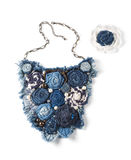 Large pendant consisting of jean flowers and brooch on white background. Large pendant consisting of jean flowers and brooch on white background Royalty Free Stock Image
