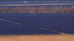 Large solar panel array slow pan left to right. Large photovoltaic solar panel array slow pan left to right - renewable energy concept stock video footage