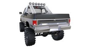 Large pickup truck off-road. Full - training. Highly raised suspension. Huge wheels with spikes for rocks and mud. 3d illustration Stock Photo