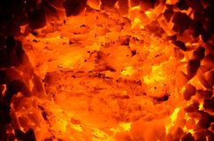 A large piece of anthracite coal burns. A huge piece of burning coal, anthracite, like a background Royalty Free Stock Image