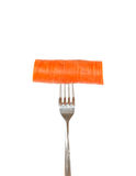 Large piece of carrot pinned on a fork Stock Photo