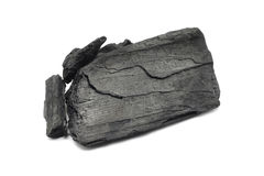 A large piece of charcoal. On white background Royalty Free Stock Photo