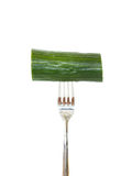Large piece of cucumber pinned on a fork Stock Image