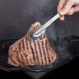 Large piece of fresh beef meat prepared on a grill pan Royalty Free Stock Images