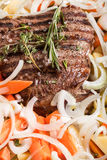 Large piece of fresh beef meat prepared on a grill pan with herb Stock Photography