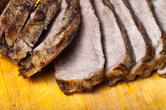 Large piece of fresh beef meat prepared on a grill pan on light Royalty Free Stock Images