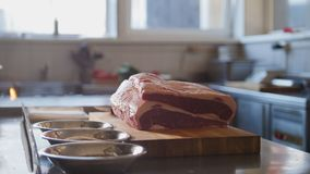 Large piece of fresh raw meat lying on a wooden board in a restaurant ready waiting for cooking. Cooking and Haute cuisine concept Royalty Free Stock Images