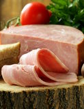 Large piece of ham on a cutting board. Stump Royalty Free Stock Photography