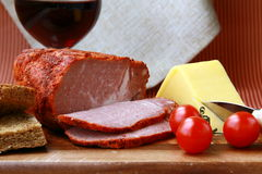 Large piece of ham in pepper Stock Image