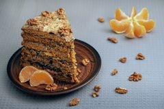 A homemade honey cake made witn nuts and prune on a ceramic plate royalty free stock photo