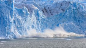 Large piece of ice collapses  at the Perito Moreno Glacier Royalty Free Stock Images