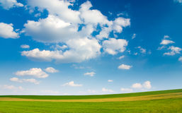 Large piece of land and blue c. Loudy sky (can be used how background or wallpaper Royalty Free Stock Photography