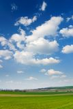 Large piece of land and blue cloudy sky Stock Photos