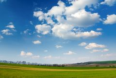 Large piece of land and blue cloudy sky Royalty Free Stock Photography