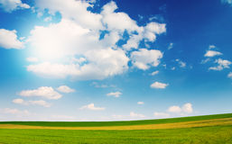 Large piece of land and blue cloudy sky Royalty Free Stock Photo