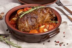 A large piece of meat baked with vegetables royalty free stock image