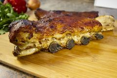 Baked pork ribs. Delicious appetizing fried ribs. stock image