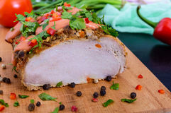 Large piece pork baked ham, with green onions and sauce on the cutting board Royalty Free Stock Image